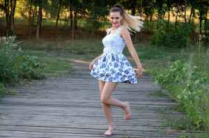 woman in blue and white skated dress